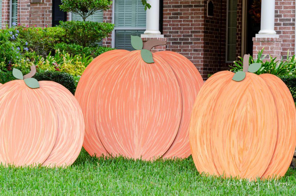 painted wooden pumpkin fall decoration outdoor