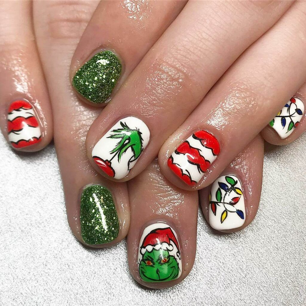 green and white grinch nails