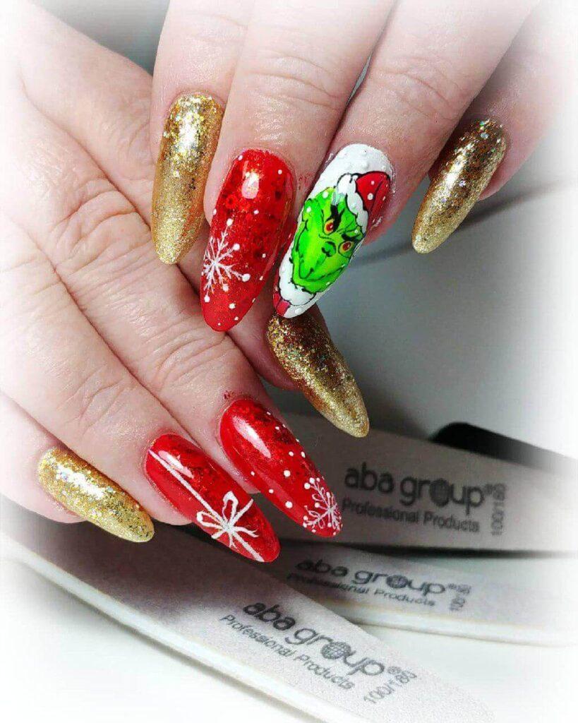 red and golden grinch nails